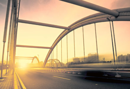 42795843 - road through the bridge with blue sky background of a city